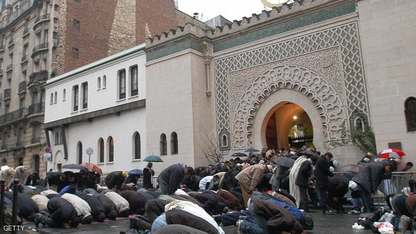 Muslims pray outside the Grand Mosque in