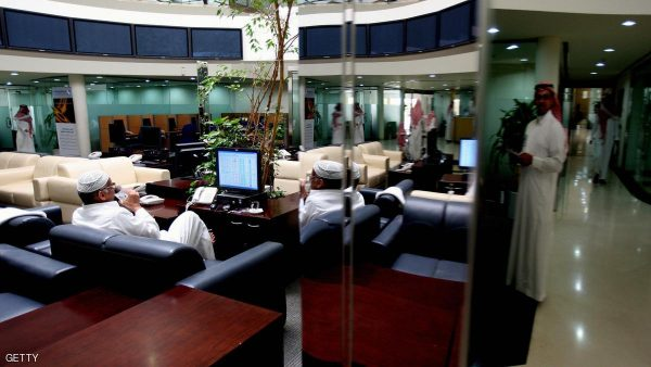 Saudi traders work at a Bank in Riyadh o