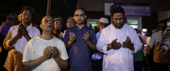 Community members pray outside the Al-Furqan Jame Mosque in Ozone Park after imam Maulama Akonjee and friend Thara Uddin were killed in the Queens borough of New York City, August 13, 2016.  An imam and his assistant were both shot in the head and killed in New York Saturday, police said, in an attack with unclear motives. / AFP / KENA BETANCUR        (Photo credit should read KENA BETANCUR/AFP/Getty Images)