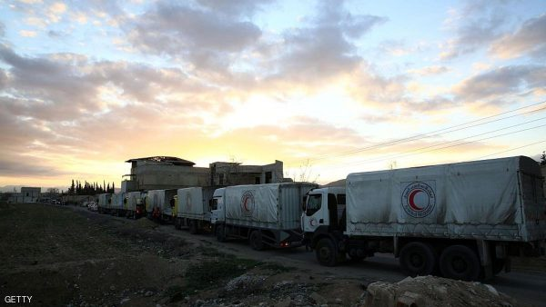 CORRECTION - A convoy of aid from the Syrian Arab Red Crescent drives through the rebel-held town of Douma, on the outskirts of the capital Damascus on March 4, 2016 on its way to the town of Saqba. The 23 trucks of the convoy delivered the aid -included food, medical supplies and nutrition products for children- to 20,000 people living in the towns of Saqba, Ain Terma, and Hazzeh. Eastern Ghouta, besieged by pro-government forces since 2013, was regularly and heavily bombarded by the regime, but had been relatively calm since a truce began. / AFP / Abd Doumany / The erroneous mention[s] appearing in the metadata of this photo by Abd Doumany has been modified in AFP systems in the following manner: [Douma] instead of [Saqba]. Please immediately remove the erroneous mention[s] from all your online services and delete it (them) from your servers. If you have been authorized by AFP to distribute it (them) to third parties, please ensure that the same actions are carried out by them. Failure to promptly comply with these instructions will entail liability on your part for any continued or post notification usage. Therefore we thank you very much for all your attention and prompt action. We are sorry for the inconvenience this notification may cause and remain at your disposal for any further information you may require.        (Photo credit should read ABD DOUMANY/AFP/Getty Images)
