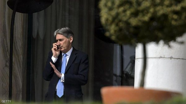 British Foreign Secretary Philip Hammond talks on his mobile as he stands on the terrace of the hotel Bean-Rivage Palace during Iran nuclear talks at the hotel in Lausanne, on March 31, 2015. Foreign ministers from major powers kicked off early a final scheduled day of talks aimed at securing the outlines of a potentially historic nuclear deal with Iran by a midnight deadline.  AFP PHOTO / FABRICE COFFRINI        (Photo credit should read FABRICE COFFRINI/AFP/Getty Images)