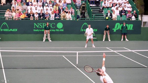 2 Jul 2000:  Bjorn Borg of Sweden serves to John McEnroe of the USA during the NSPCC Challenge at Buckingham Palace in London.  Mandatory Credit: Mike Hewitt /Allsport