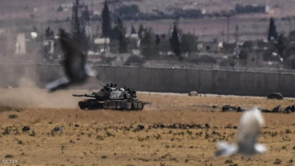 TOPSHOT - Birds fly near a Turkish tank coming from Syria during clashes between Turkish army and ISIS militants on September 4, 2016 at Elbeyli, in the southern region of Kilis. Ankara stepped up its fight against militants in Turkey and northern Syria with air strikes on Kurdish rebel positions in the restive southeast and IS extremists in northern Syria, security sources said on September 4, 2016.  / AFP / BULENT KILIC        (Photo credit should read BULENT KILIC/AFP/Getty Images)