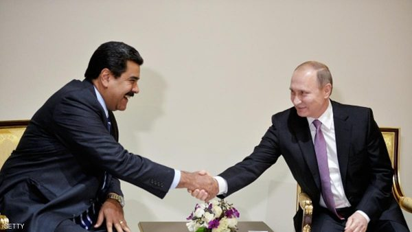 Russian President Vladimir Putin (R) shakes hands with his Venezuelan counterpart Nicolas Maduro during a meeting on the sidelines of the Gas Exporting Countries Forum (GECF) summit in Tehran on November 23, 2015. AFP PHOTO / SPUTNIK / ALEXEI DRUZHININ / AFP / SPUTNIK / ALEXEI DRUZHININ        (Photo credit should read ALEXEI DRUZHININ/AFP/Getty Images)