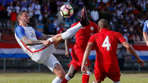 HAVANA, CUBA - OCTOBER 07:  Geoff Cameron #20 of the United States attempts a shot on goal against Yasmani Lopes Escalante #4 of Cuba at Estadio Pedro Marrero on October 7, 2016 in Havana, Cuba.  (Photo by Kevin C. Cox/Getty Images)