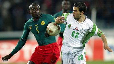 SOUSSE, TUNISIA:  Algeria's Hocine Achiou (R) fights for the ball with Cameroon's defender Thimotee Atouba  25 January 2004 at the Olympic stadium in Sousse, during their African Nations Cup 2004 match. The match ended in a 1-1 draw.     AFP PHOTO FRANCK FIFE  (Photo credit should read FRANCK FIFE/AFP/Getty Images)