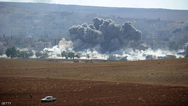 SANLIURFA, TURKEY -  OCTOBER 28: (TURKEY OUT)  An explosion following an air-strike in the Syrian town of Kobani from near the Mursitpinar border crossing on the Turkish-Syrian border in the southeastern town of Suruc in Sanliurfa province October 28, 2014. It has been reported that 150 Iraqi peshmerga from Iraq's northern Kurdistan region, armed with American weapons, are expected to arrive in Turkey later today following authorization of their deployment last week.  The Iraqi peshmerga fighters will fly into Turkey and travel by land across the Syrian border to provide logistical and artillery support to their Syrian counterparts, but will not be involved in frontline combat. (Photo by Kutluhan Cucel/Getty Images)