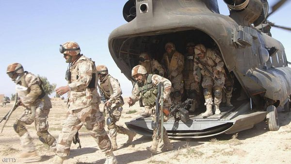 BRASSFIELD MORA, IRAQ - MARCH 16: In this U.S. Military handout, Iraqi Army Soldiers from 4th Iraqi Army Division leave a CH-47 Chinook helicopter during of Operation Swarmer March 16 in Brassfield Mora, Iraq.   According to reports U.S military said on March 16, 2006 that more than 1,500 Iraqi and Coalition troops launched operation Swarmer, the largest air assault operation since Operation Iraqi Freedom, reportedly to clear a suspected insurgent operating area northeast of Samarra,  about 60 miles north of Baghdad, Iraq.  (Photo by Shawn Hussong/U.S. Navy via Getty Images)