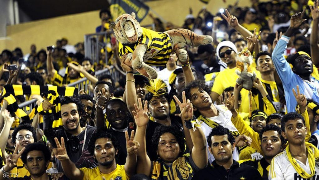 Saudi Al-Ittihad club fans cheer for the